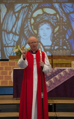 A photo of Bishop James Langstaff as he blesses and inaugurates St Gabriel's Church, Kings Hill